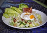 Salad of cos lettuce with crouton, cacon, parmesan poached egg and anchovy dressing