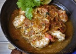 Sizzling Prawns with ginger lime and chilli garnished with lime and coriander