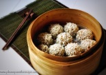 A bamboo steamer basket with Steamed Rice Studded Meatballs