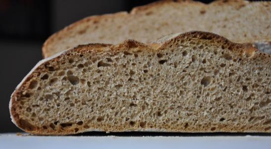 cut loaf showing open texture of spelt sourdough bread